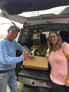 Tom and Jennifer Greenwell with donated coffee.