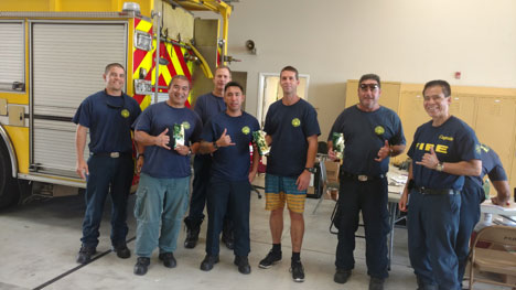 Puna district firefighters appreciating the generosity of Greenwell Farms' customers, whose coffee donations will help get them through some long days and nights protecting the Puna community.
